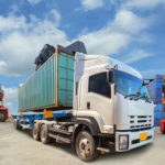 Truck with Industrial Container Cargo for Logistic Import Export at yard.